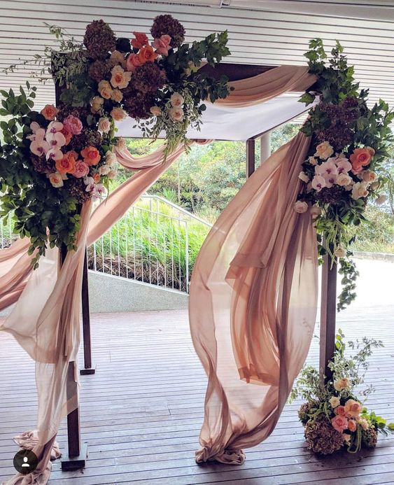 romantic dusty rose wedding decor arch ideas with lush of flowers