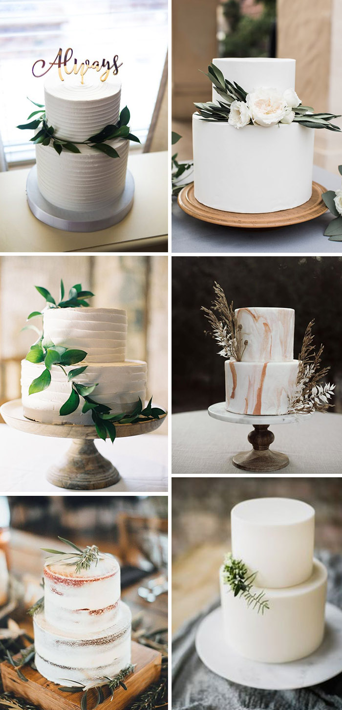 simple and minimal white two-tier wedding cakes with eucalyptus greenery