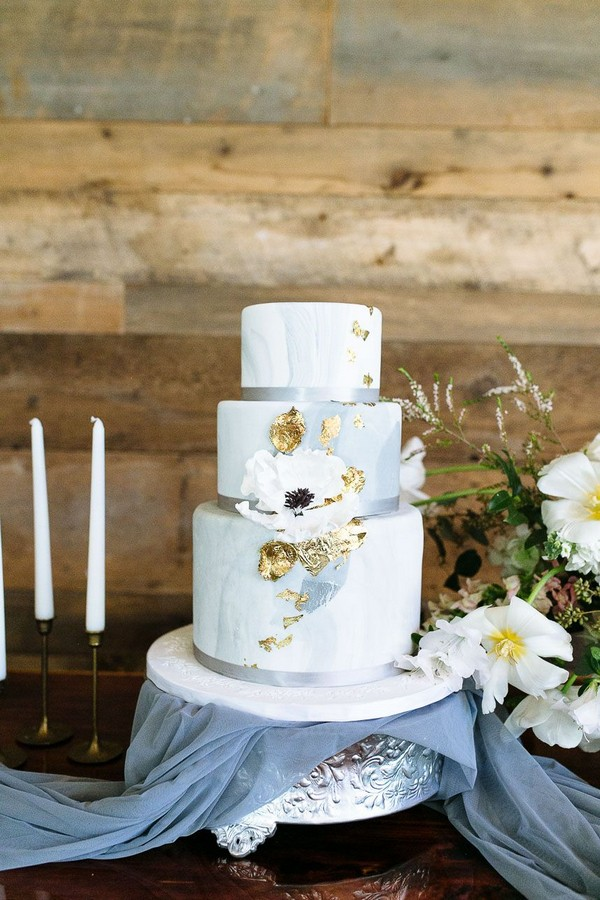simple dusty blue wedding cake with gold foil