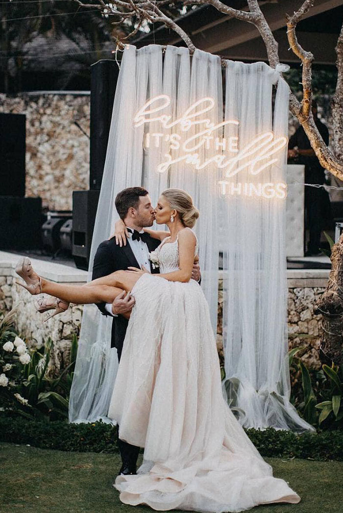 stylish simple diy wedding drapery backdrop with letter lights