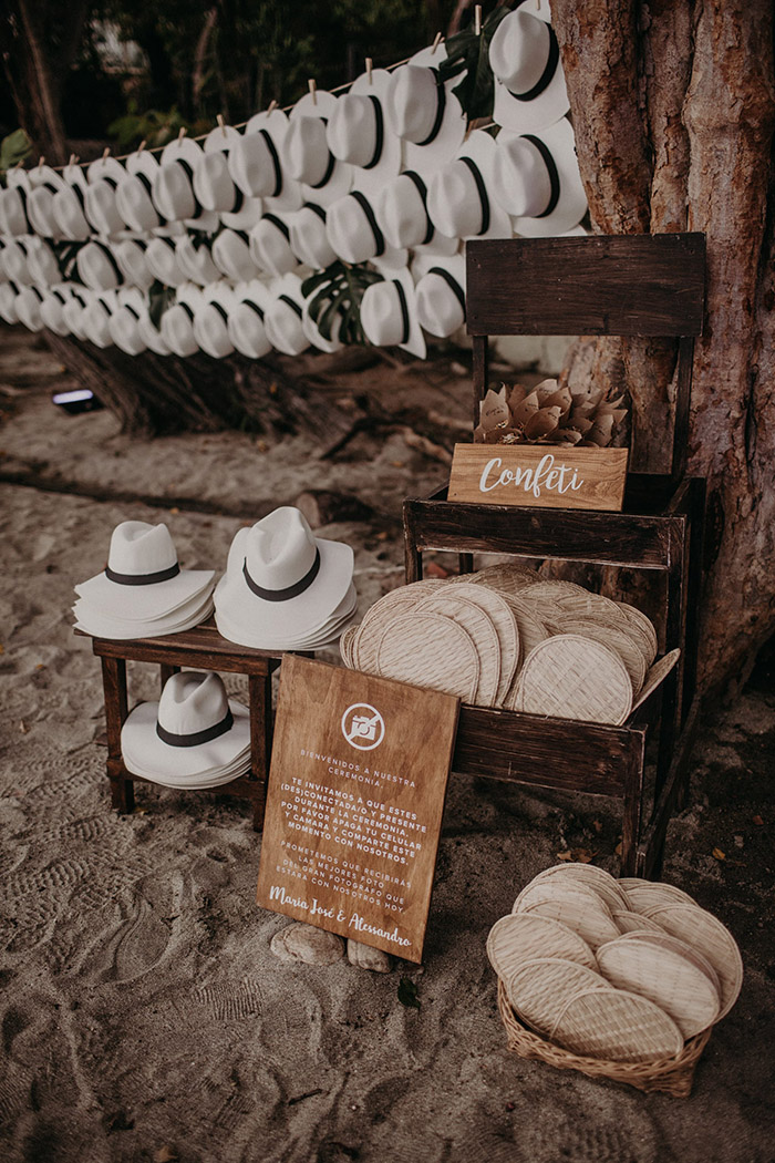 sweet beach wedding ideas with hats and fans for wedding guests