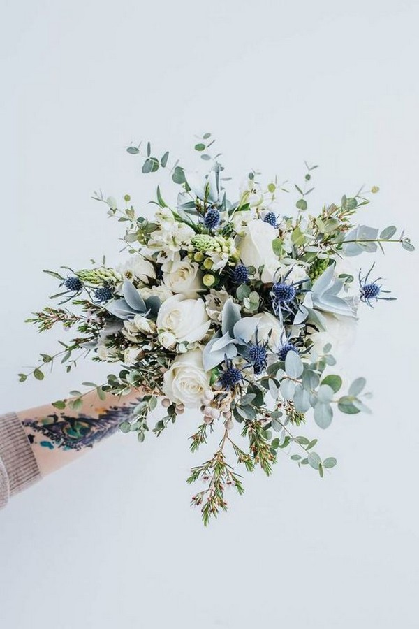 white roses and silver eucalyptus wedding bouquet