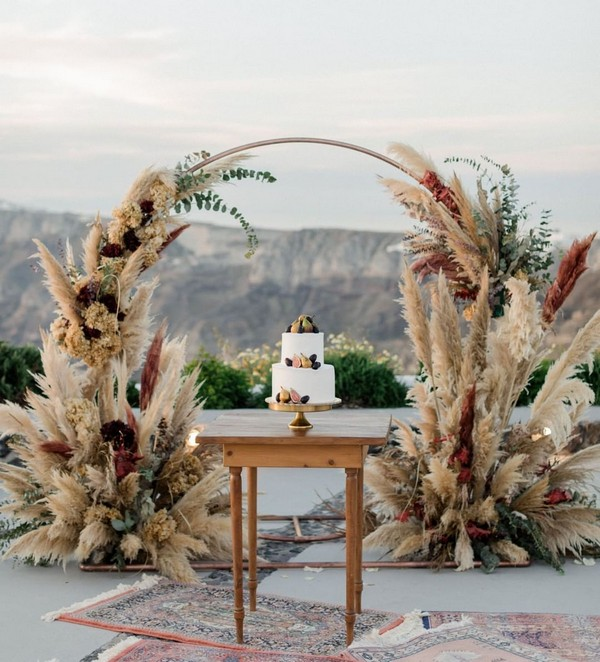 wreath wedding weremony arch with bohemain pampas grass