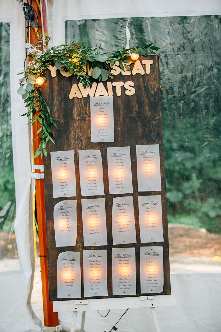 DIY rustic wedding seating board with lights