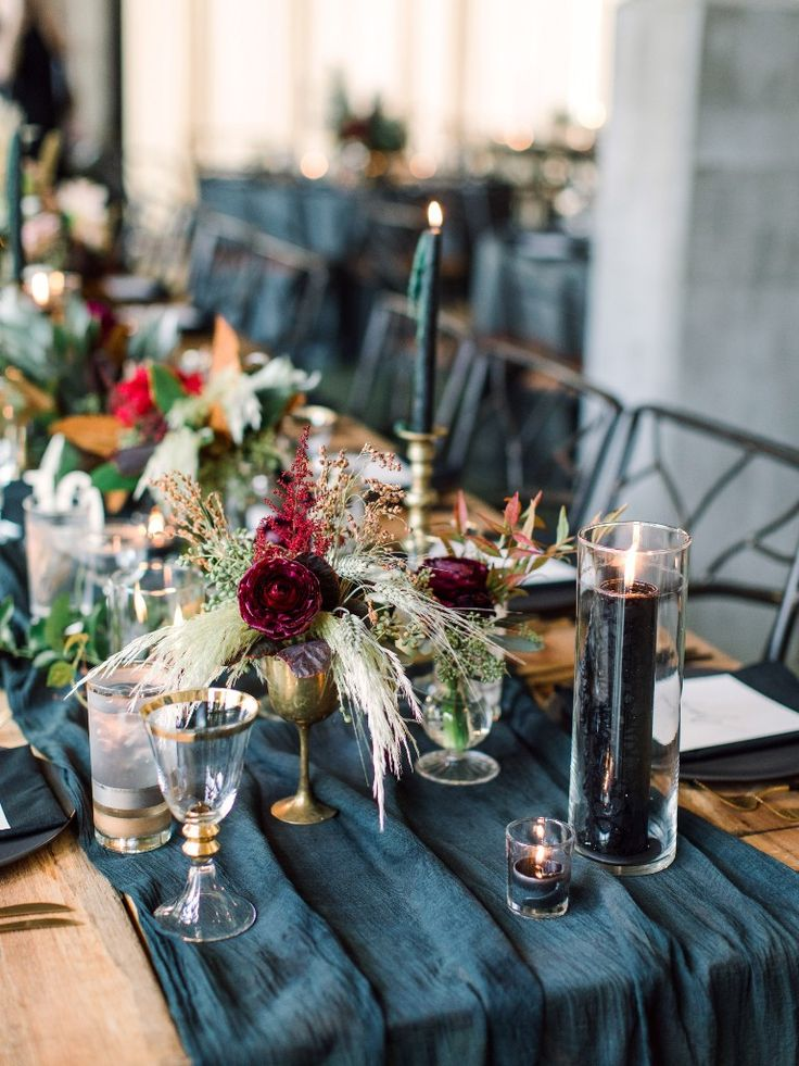 charming jewel-toned wedding centerpieces in blue and burgundy