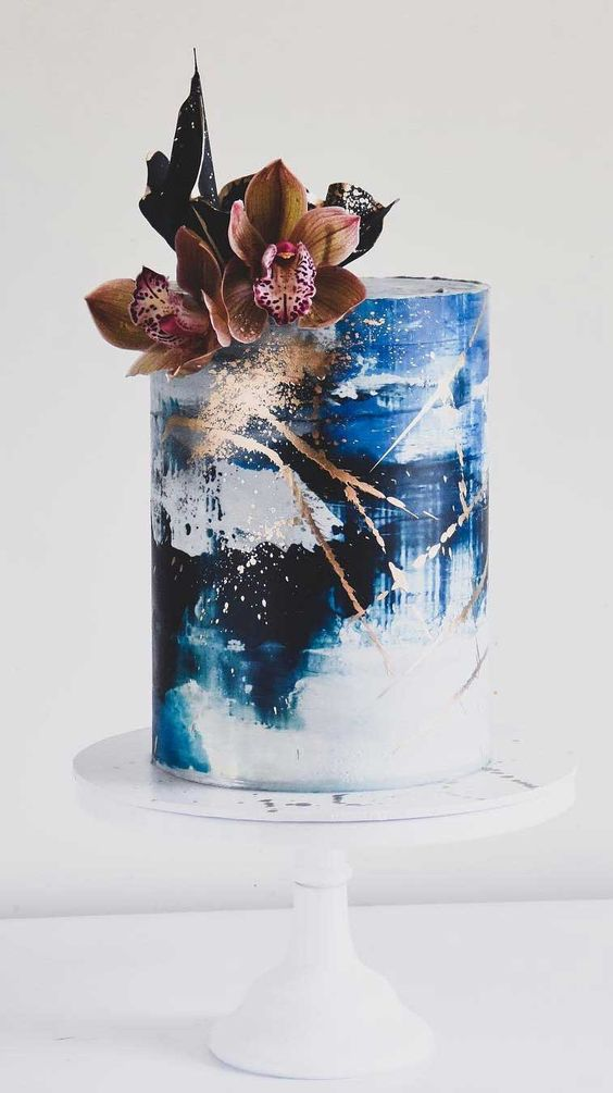 classic blue wedding blue white ombre with flowers and golden foil cake