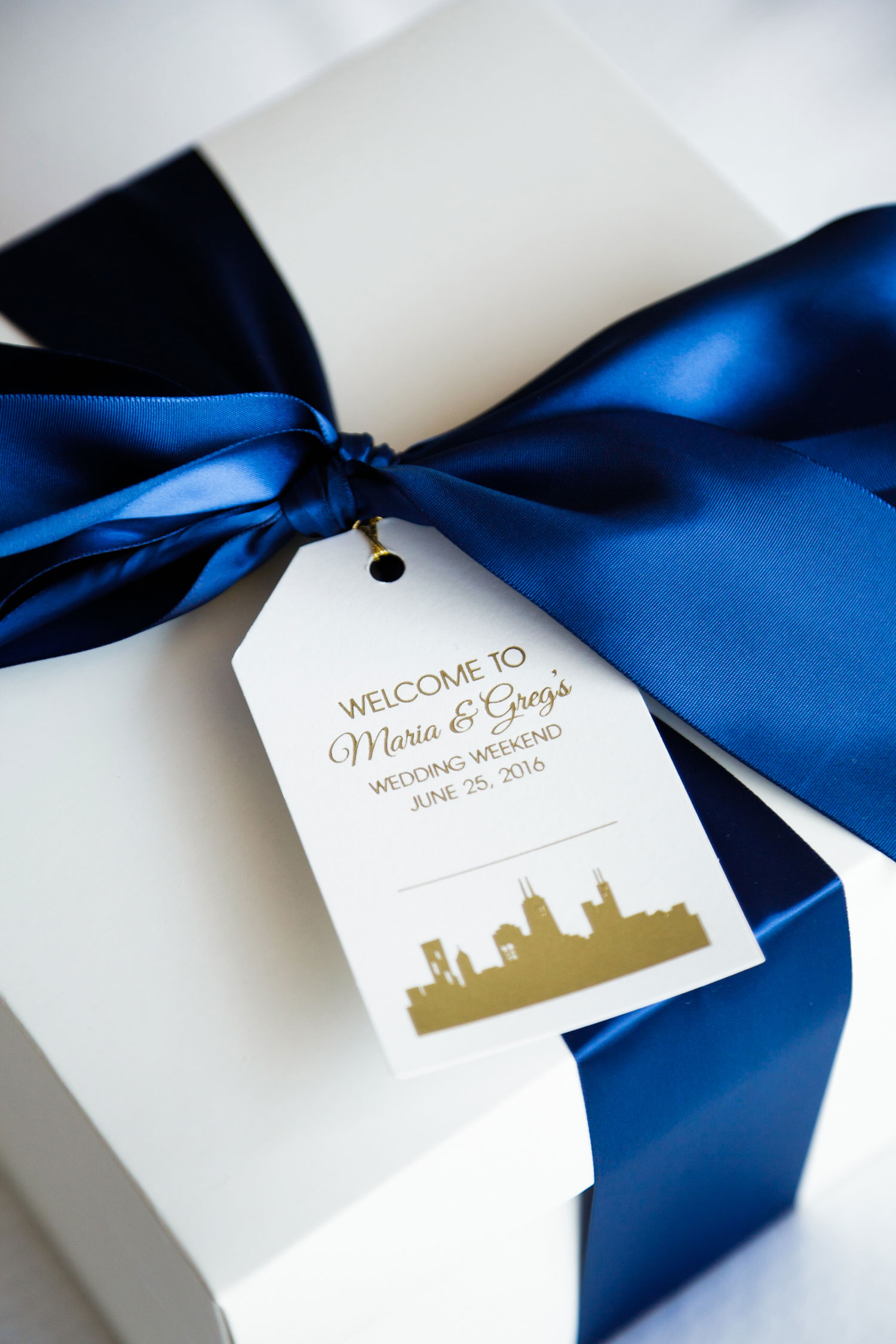 classic blue wedding welcome boxes ideas with blue ribbon and little tag