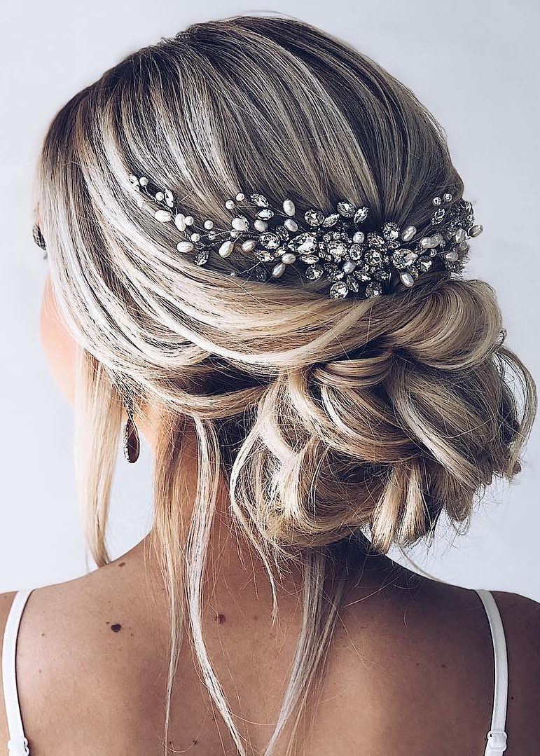 loose bridal updo with jewelry embelishment