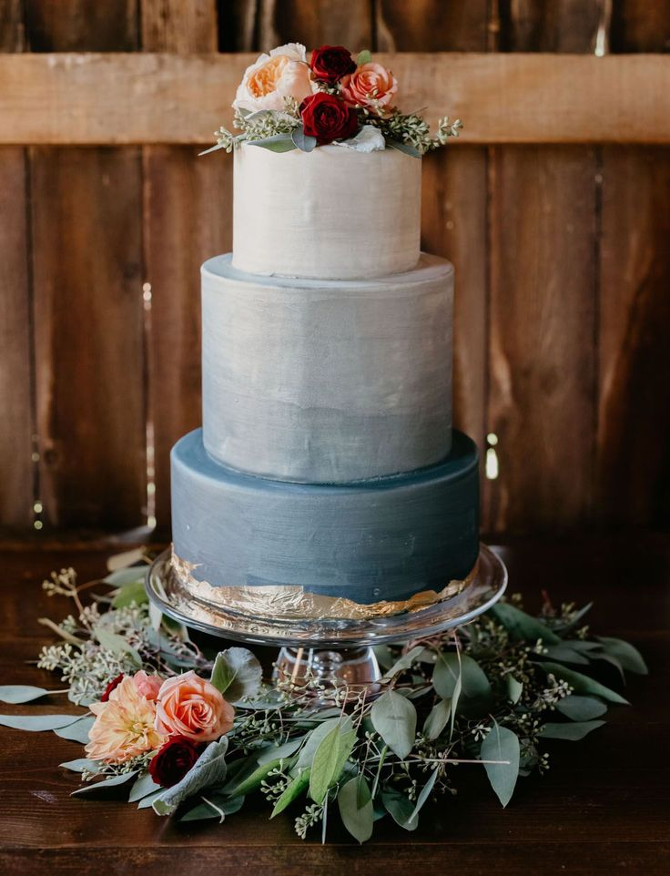 600×899 ombre dusty blue wedding cake with burgundy roses