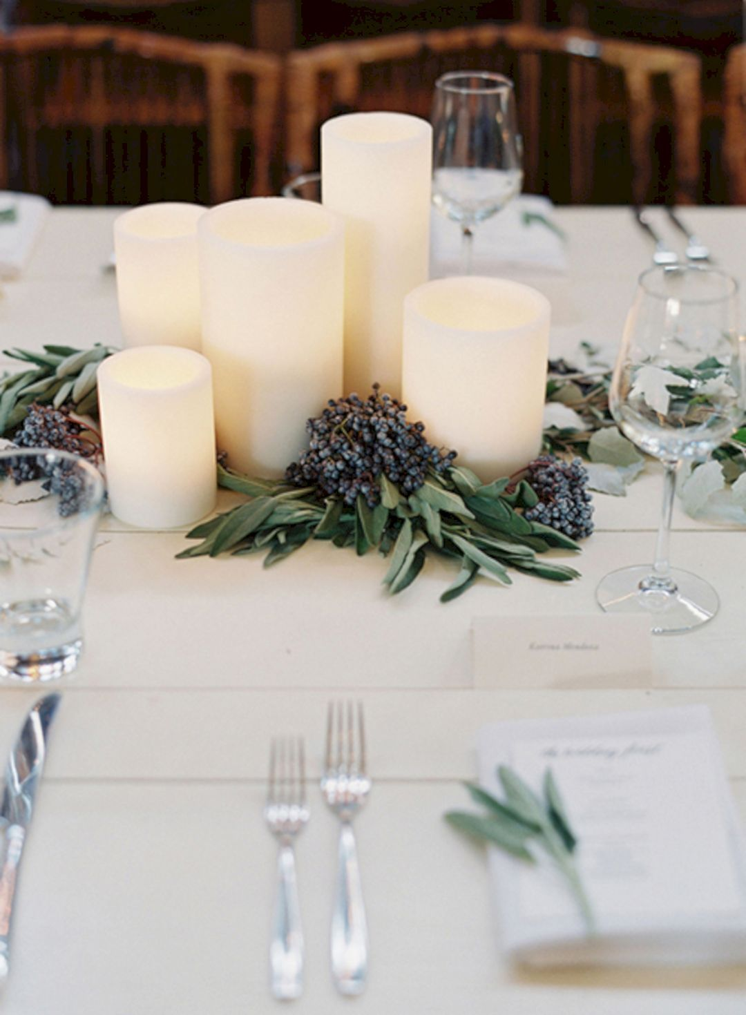 simple and minimalist sage green and candles wedding centepieces