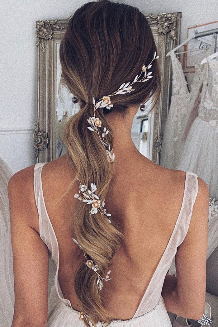 simple curly ponytail bridal hairstyle with embellishment