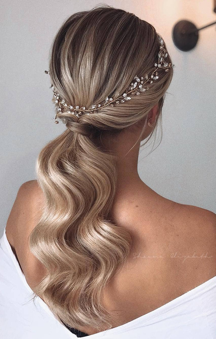 simple curly ponytail bridal hairstyle with jewellery headpiece
