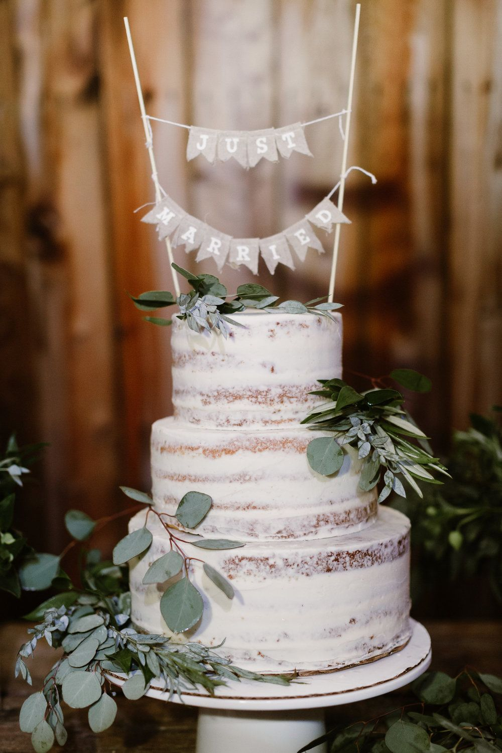 simple rustic semi-naked wedding cake with eucalyptus