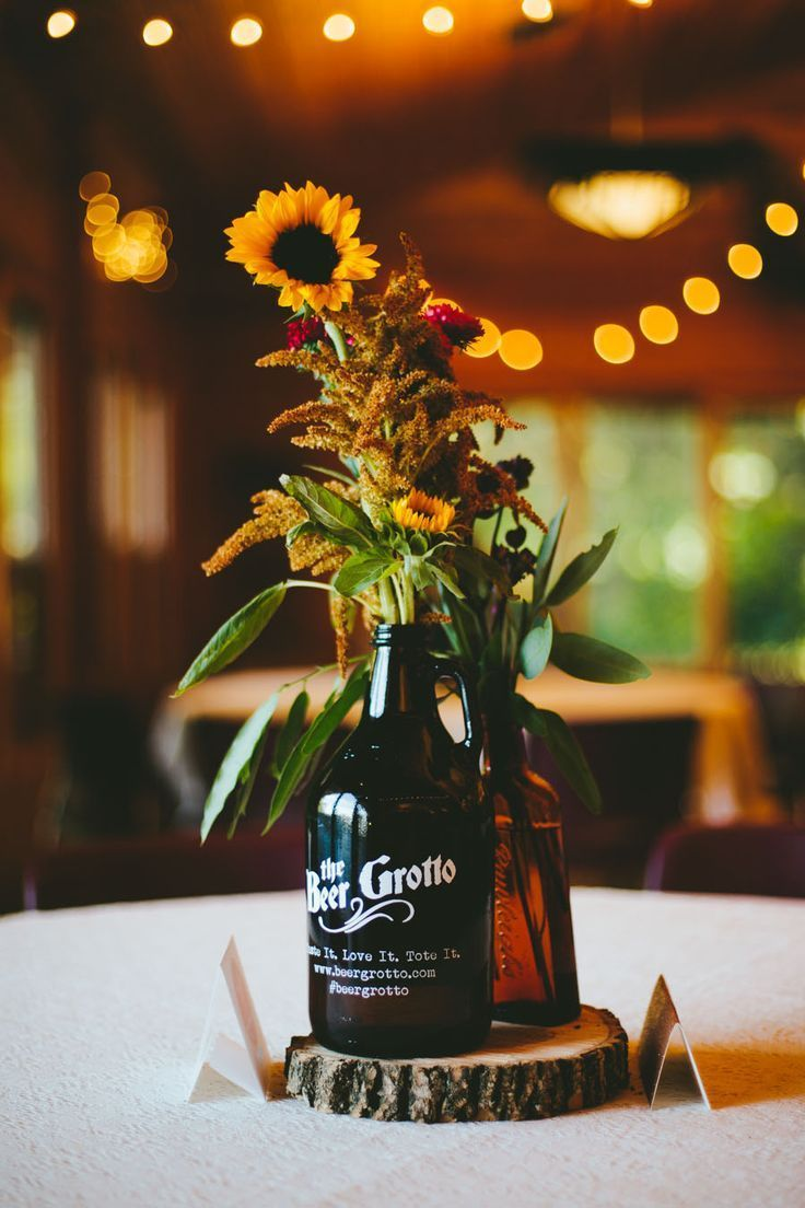 DIY rustic sunflower wedding centepieces with bottles