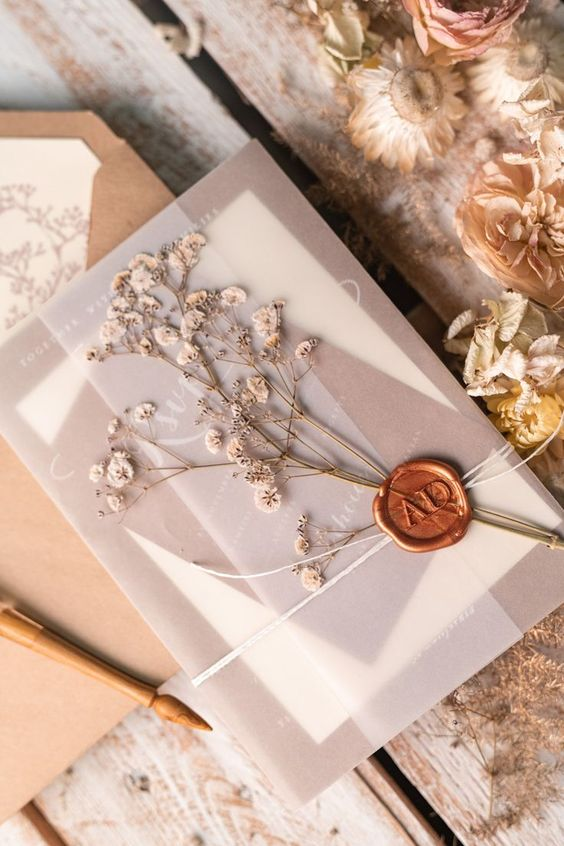 chic rustic vellum pocket wedding invitation with wax seal and dry flower
