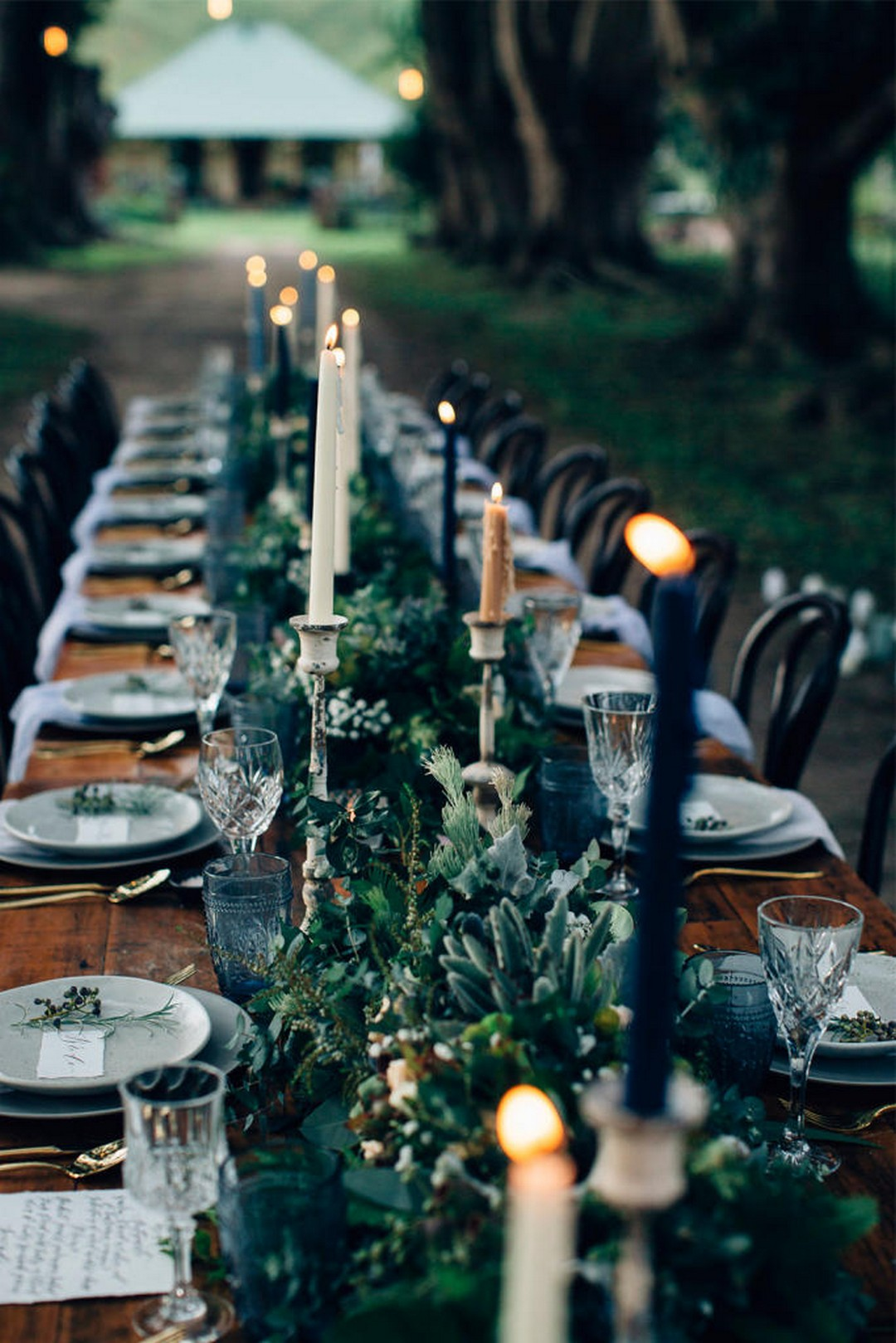 forest green and blue moody dark forest wedding centerpieces