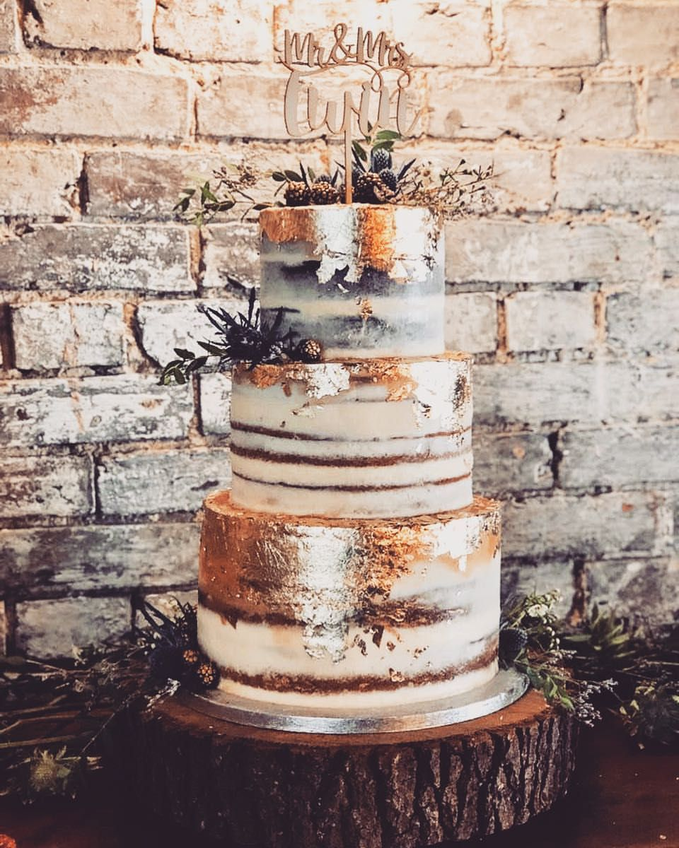 gorgeous 3 tiered semi naked wedding cake with gold leaf and thistle