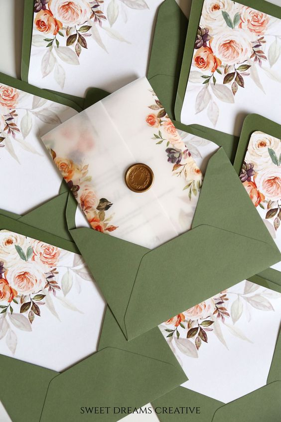 gorgeous wax seal wedding invitation with rustic vellum pocket and greenery envelop