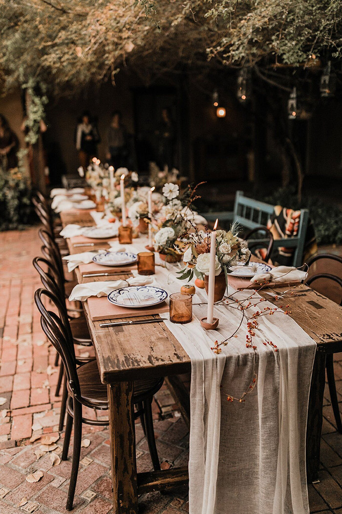 romantic hobo style wedding table settings in terracotta color