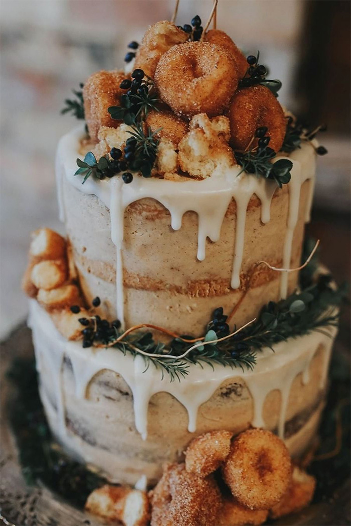 simple and creative rustic half naked wedding cake with donuts