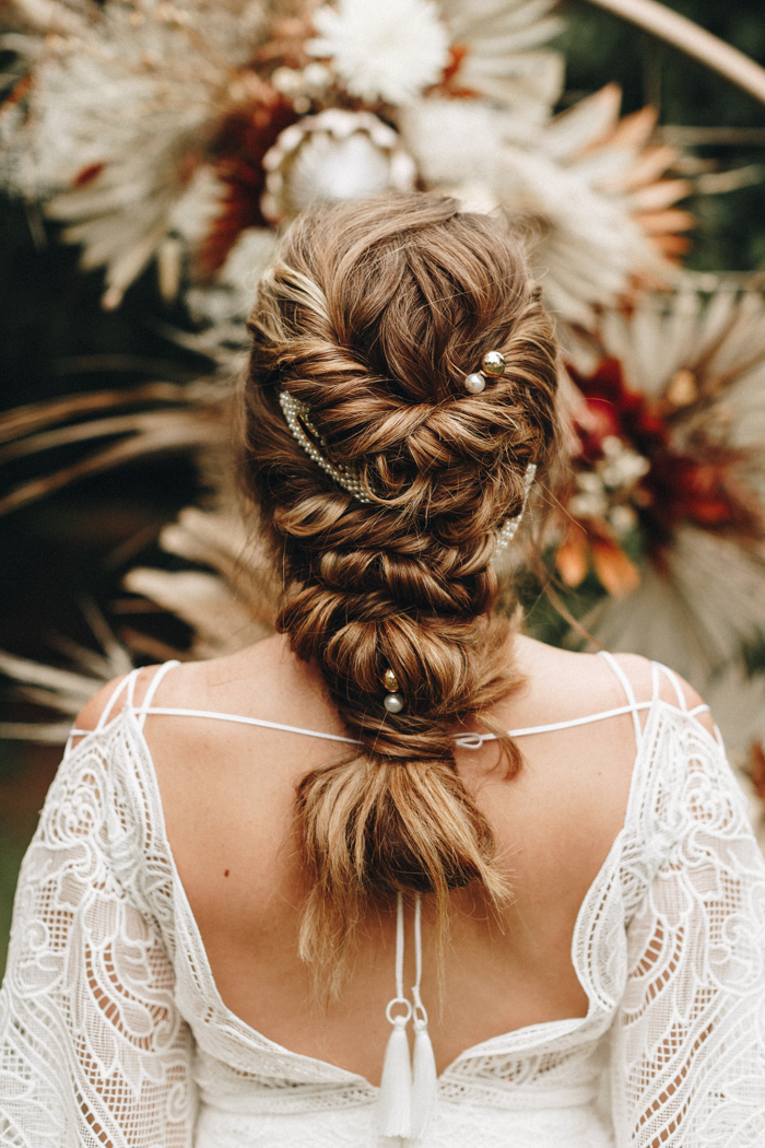 twisted wedding low ponytail for long hair