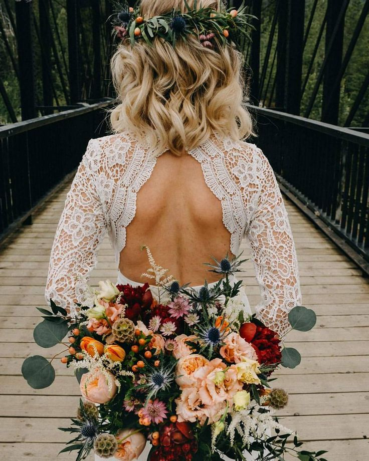 Small and Intimate Wedding Ideas to Enjoy with floral bouquet and wedding dress