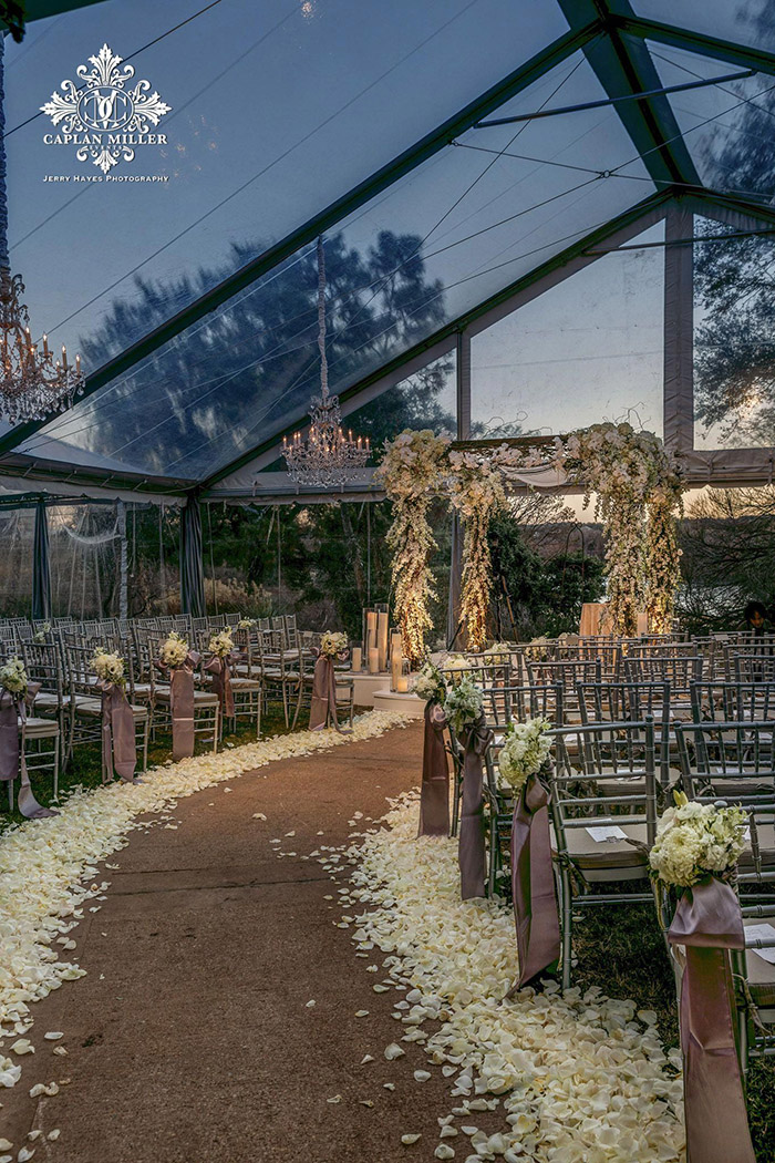 a romantic clear tented wedding ceremony