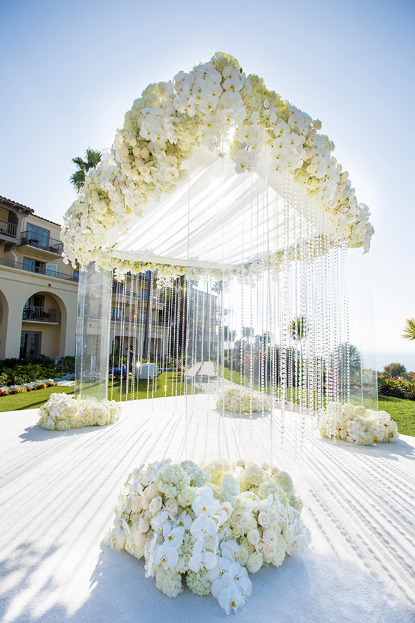 luxury all white and clear lucite outdoor wedding chuppah