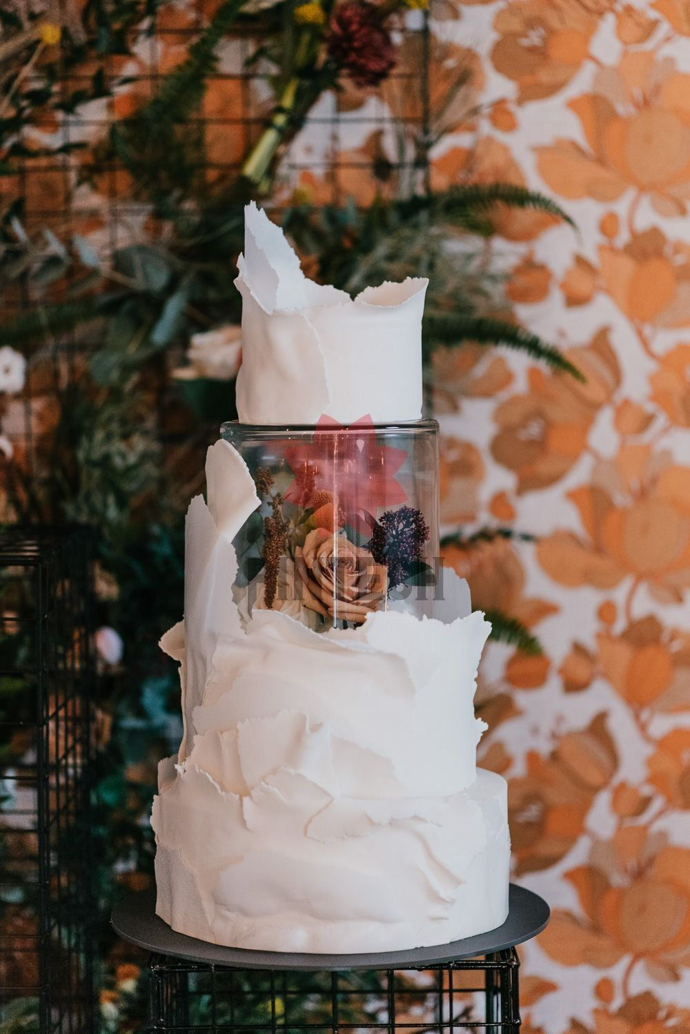 modern century white wedding cakes with flowers and lucite box