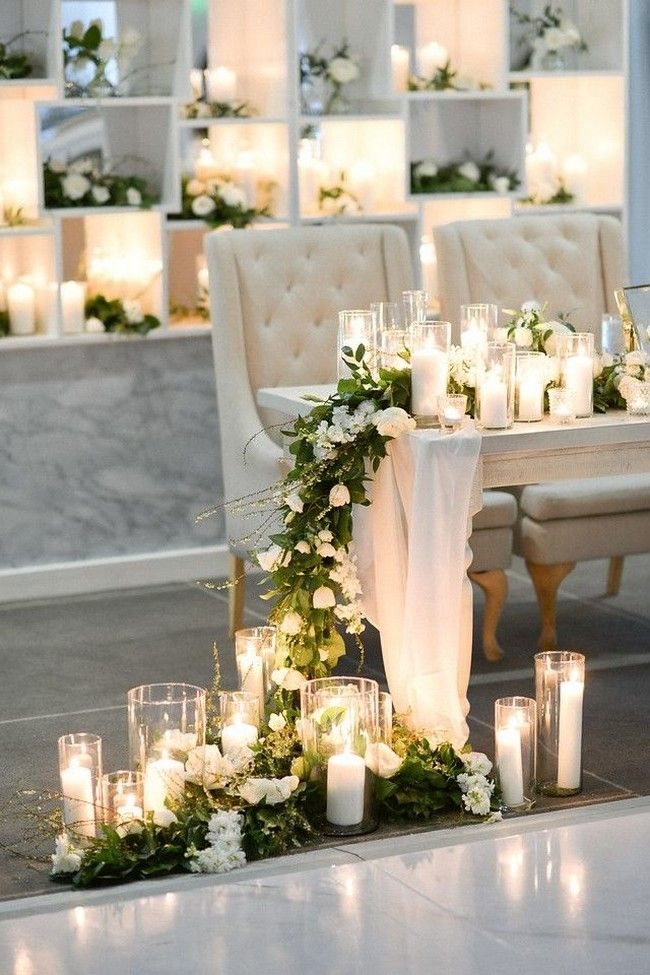 romantic candle decoration with clear glasses for bride and groom tables