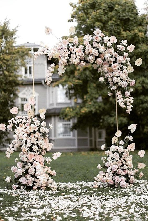 romantic small intimate wedding ideas with blush floral arch