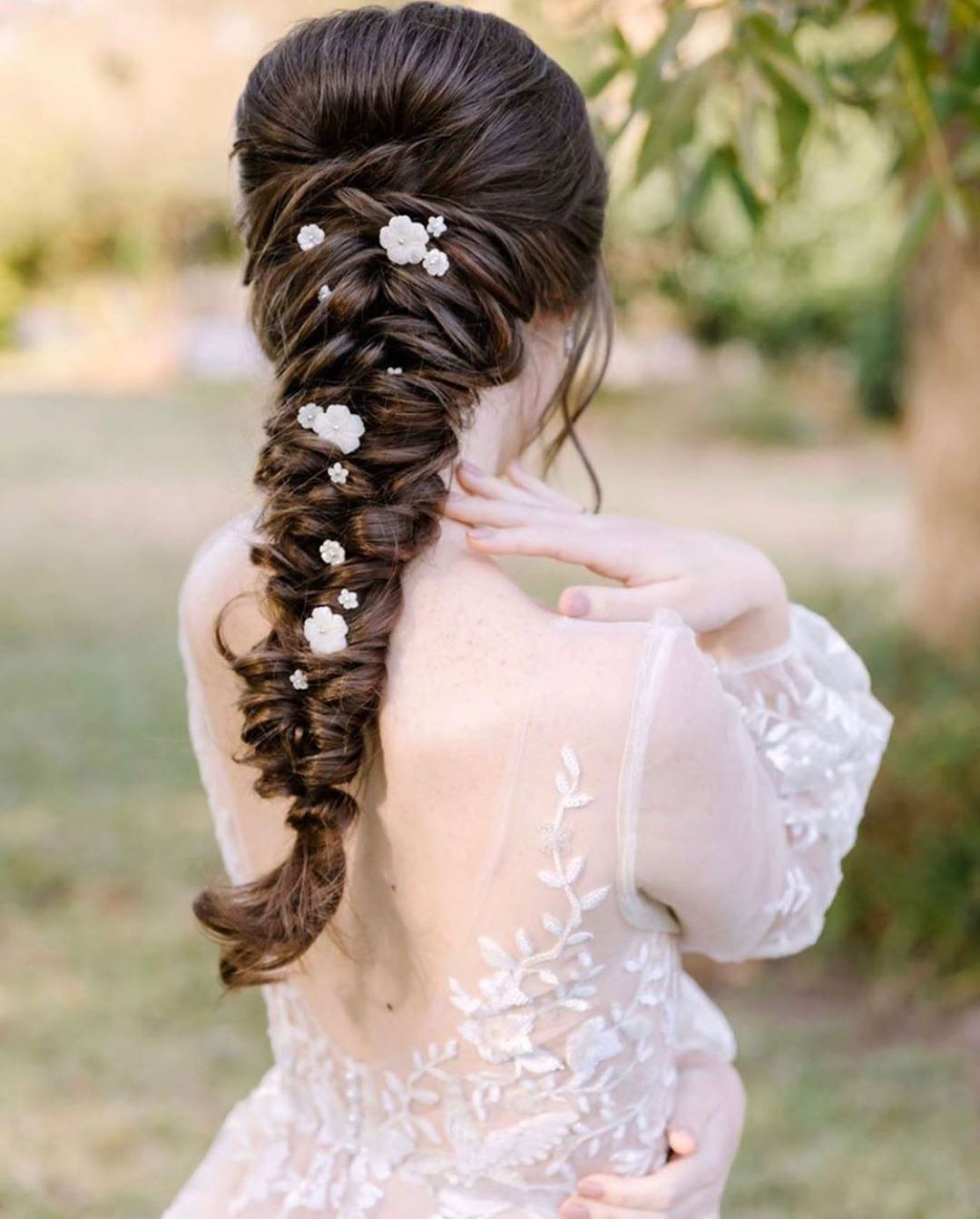 dainty flower adorned braid with a delicate boho touch