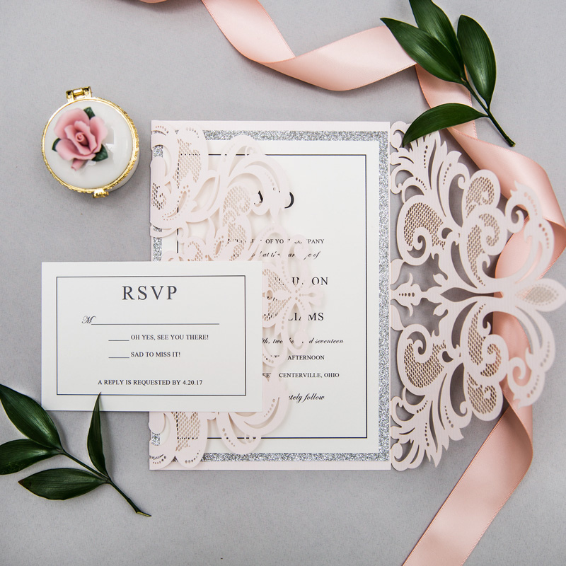 elegant upscale blush and silver glittery laser cut wedding invitation kits with belly bands and tags