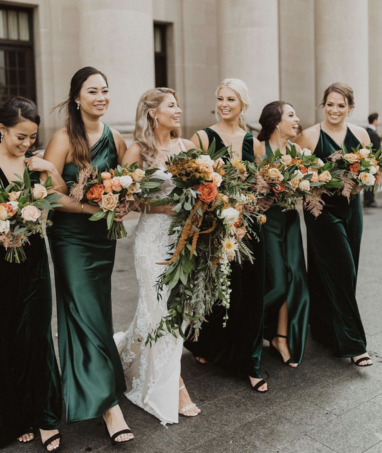 luxe emerald green velvet and satin bridesmaids dresses