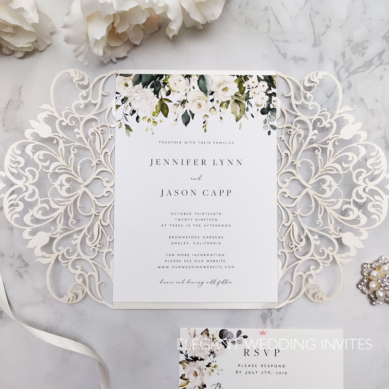 whispers of white-elegant ivory and white flowers greenery laser cut wedding invites