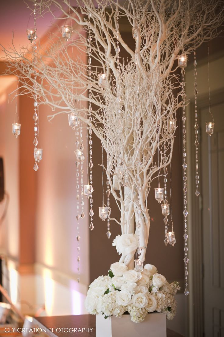 all white tree tall wedding decor with crystal for winter wonderland theme