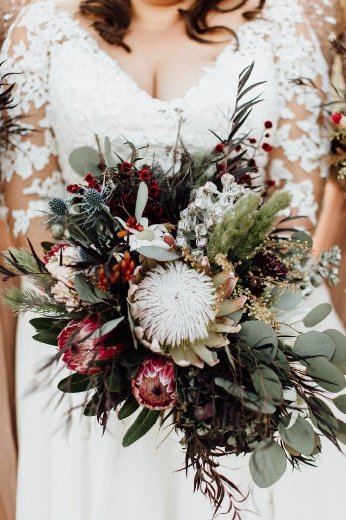australian native fall and winter wedding bouquet with proteas wattle and flannel flower