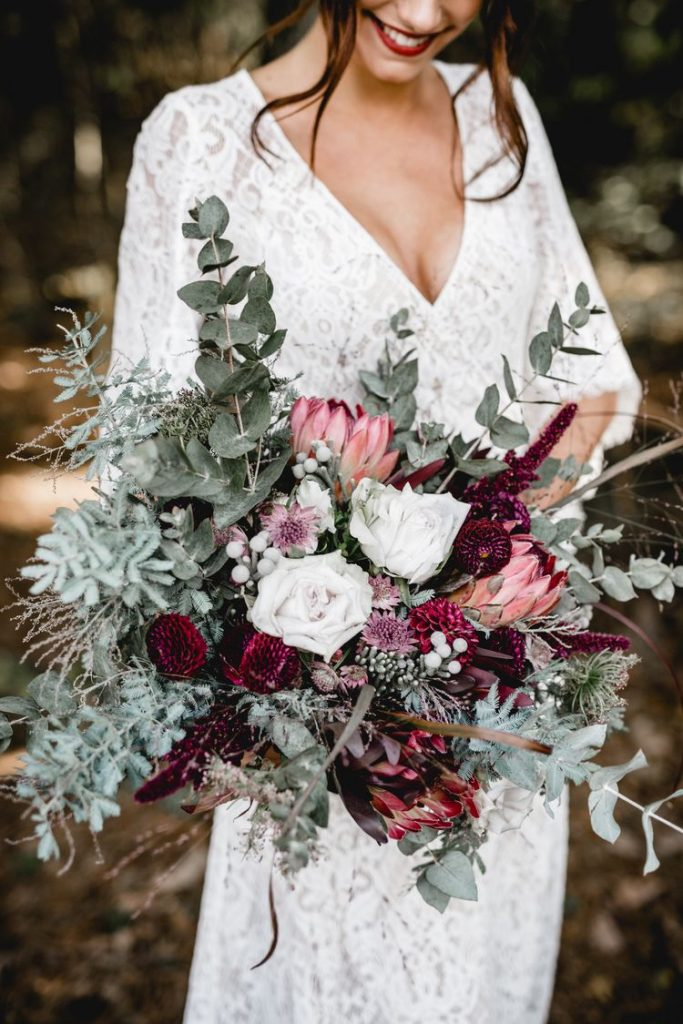 autumnal burgundy and green fall and winter bridal bouquets
