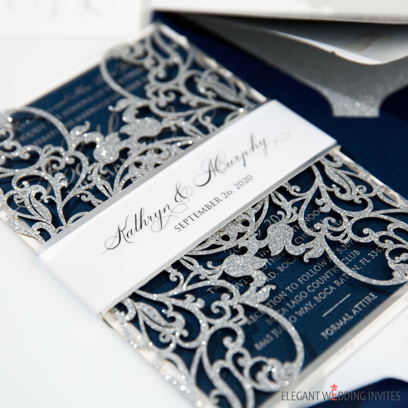 blue and silver laser cut wedding invitations with silver mirror belly band