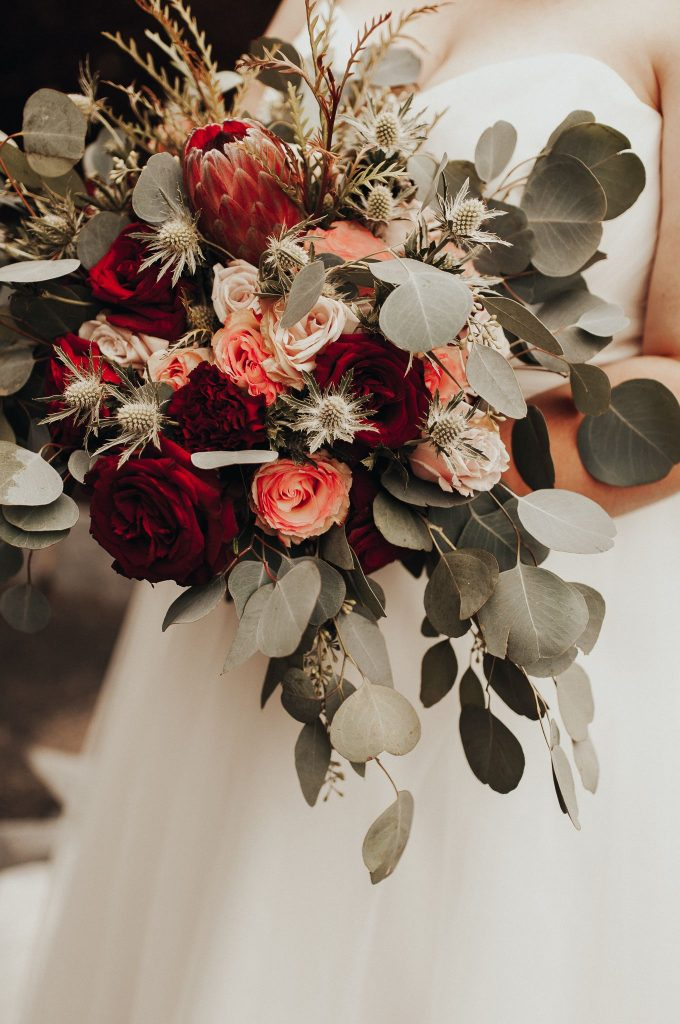 bold red rose and protea fall wedding bouquets