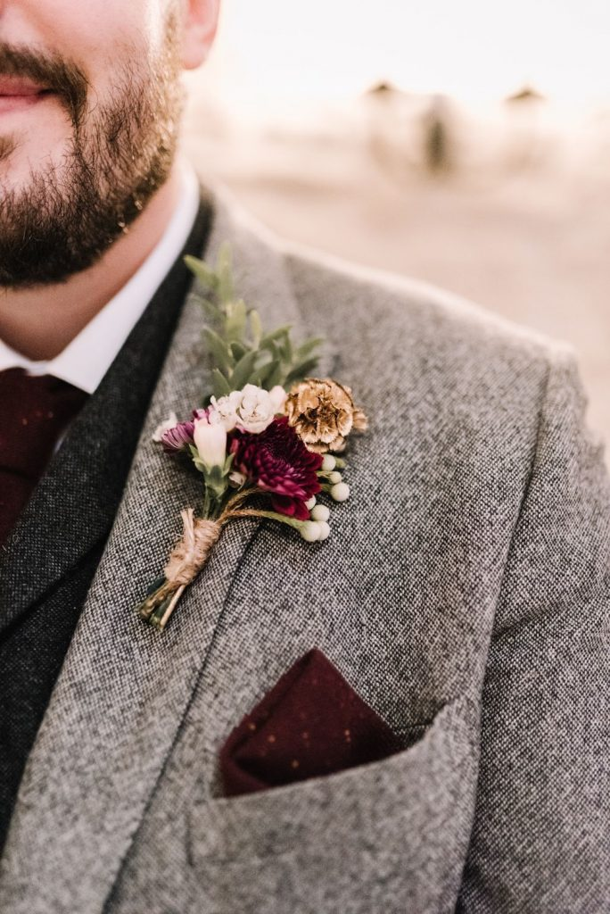 burgundy and warm grey wedding groom attire