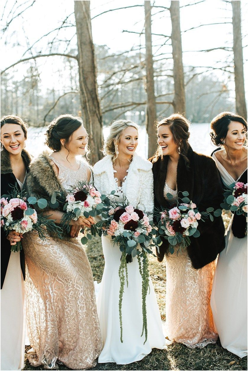 cozy and stylish winter wedding attire for bride and bridesmaid