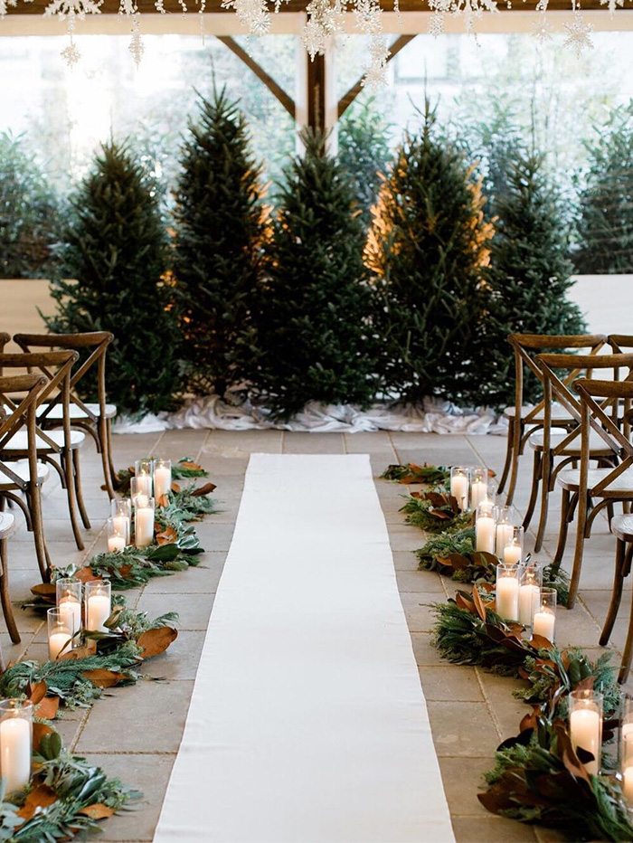 cozy indoor winter wedding ceremony with pine trees