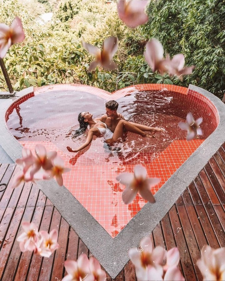 creative sweet heart pool with flower in the honeymoon hotel
