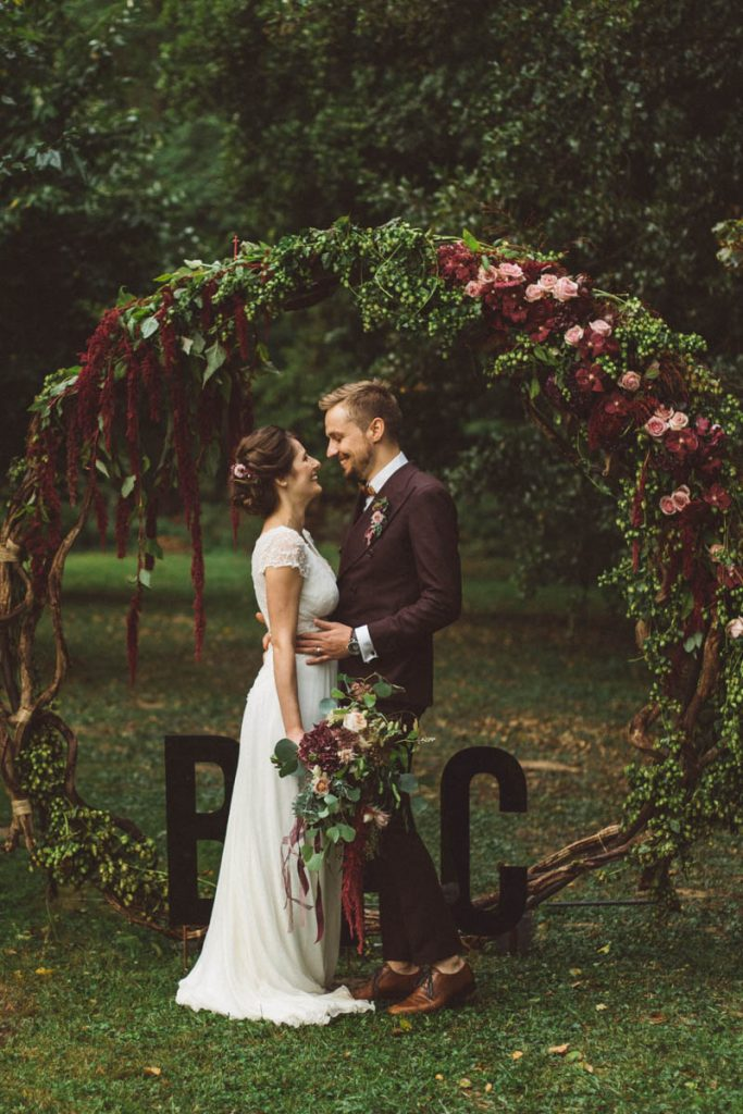dark moody flowers woodland wedding circle arch ideas