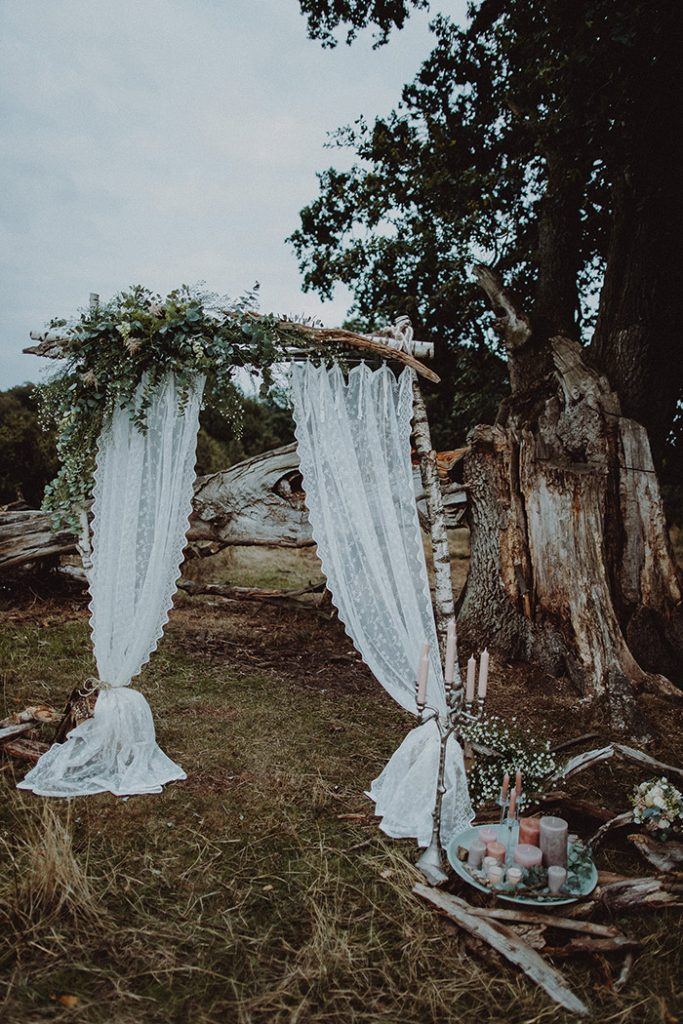 diy simple and stylish white and greenery rustic wedding arches