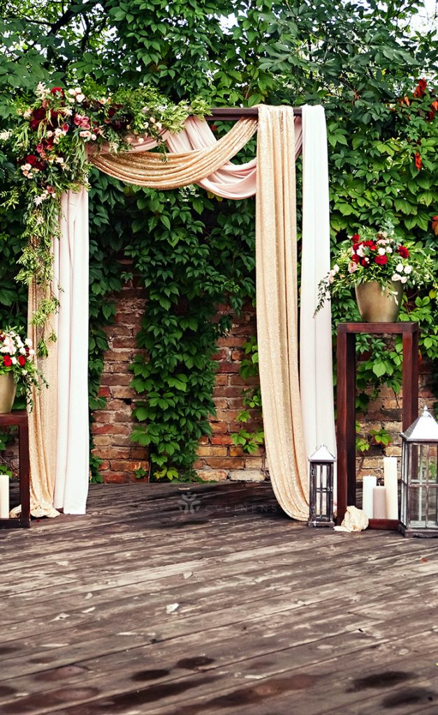 diy simple blush draped wedding arch with flowers
