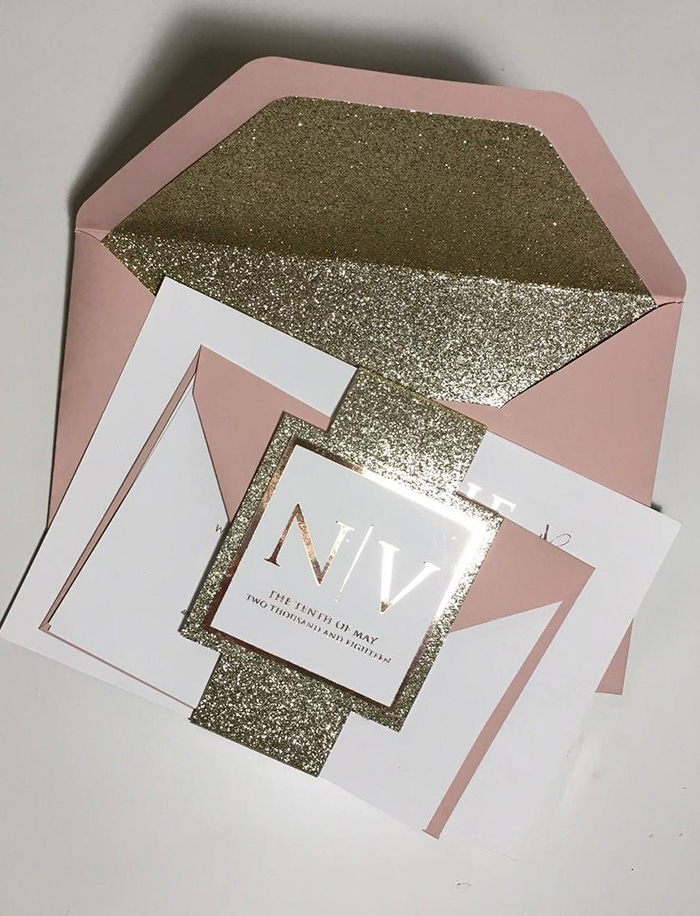 modern and simple wedding invitation with glitter belly band and envelope