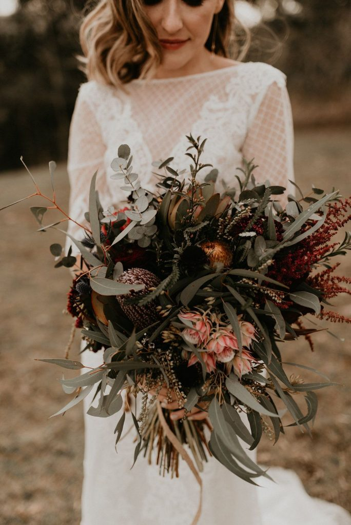 moody tone burgundy and pink winter wedding bouquets