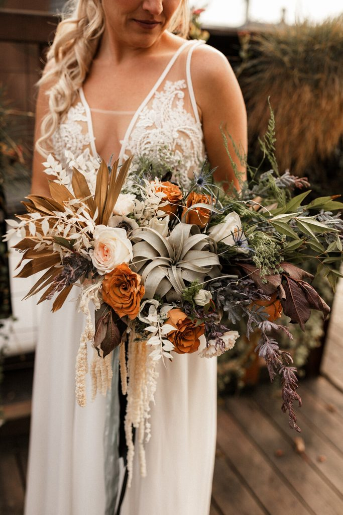 mustard yellow and sage dried plant boho wedding bouquets
